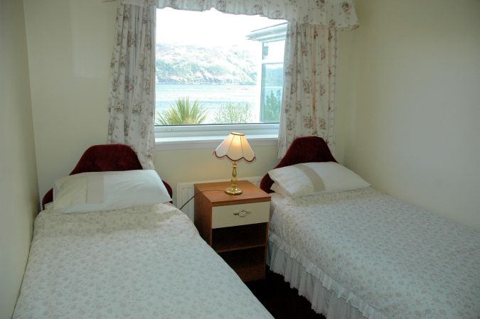 The twin bedroom in Strathardle is at the front of the house and enjoys superb views across Loch Carron.