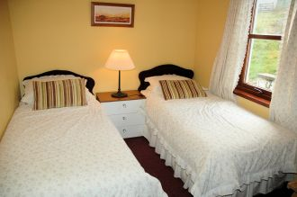 Click here for more information about the twin bedroom with photos.