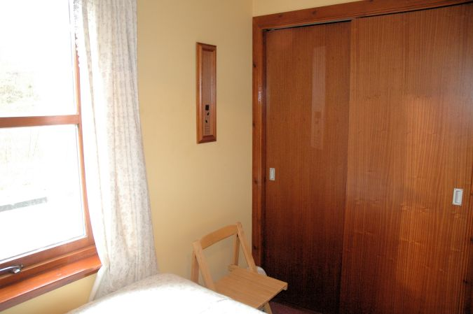 The twin bedroom in Tarlogie has a good sized built-in wardrobe.