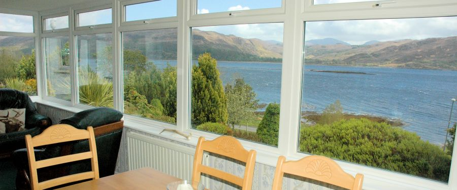 The conservatory at Strathardle is large and spacious and gives panoramic views of the sea and mountains.